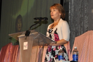 Dr. Linda Harrison welcomes more than 1,000 guests to the 2013 Komen Kansas City Pink Promise Brunch on behalf of Diagnostic Imaging Centers, P.A. in May.