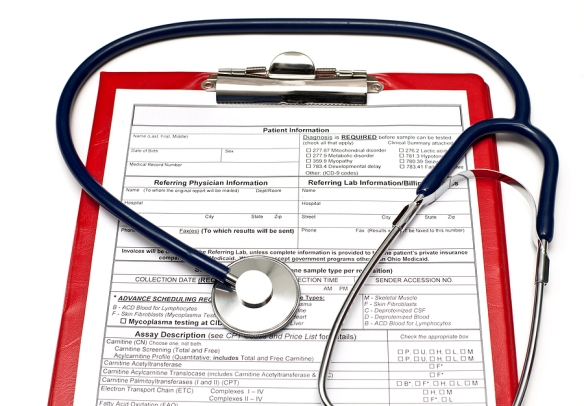 Blank Patient information on red clipboard  with stethoscope on white background