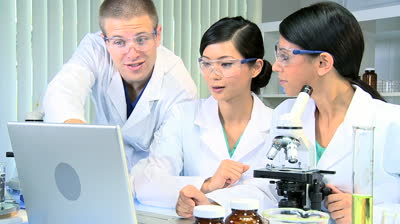 stock-footage-caucasian-doctor-with-two-medical-research-students-using-computer-technology-in-laboratory